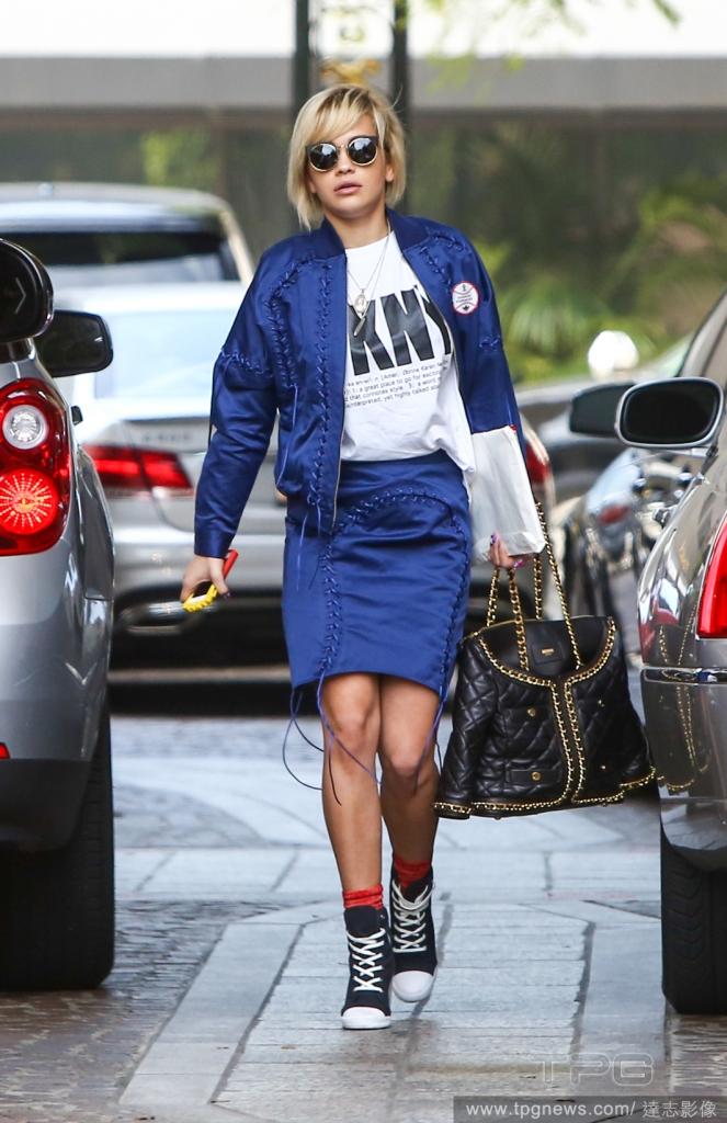 Rita Ora In Designer Labels and Black Sneakers