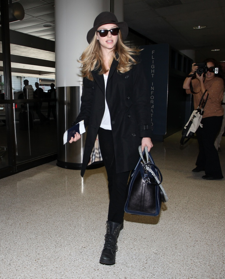 Amanda Seyfried arriving at LAX after a week in Europe promoting her new movie 'In Time' with Justin Timberlake. Pictured: Amanda Seyfried Ref: SPL332560 051111 Picture by: AKM IMAGES / Splash News Splash News and Pictures Los Angeles:310-821-2666 New York: 212-619-2666 London: 870-934-2666 photodesk@splashnews.com