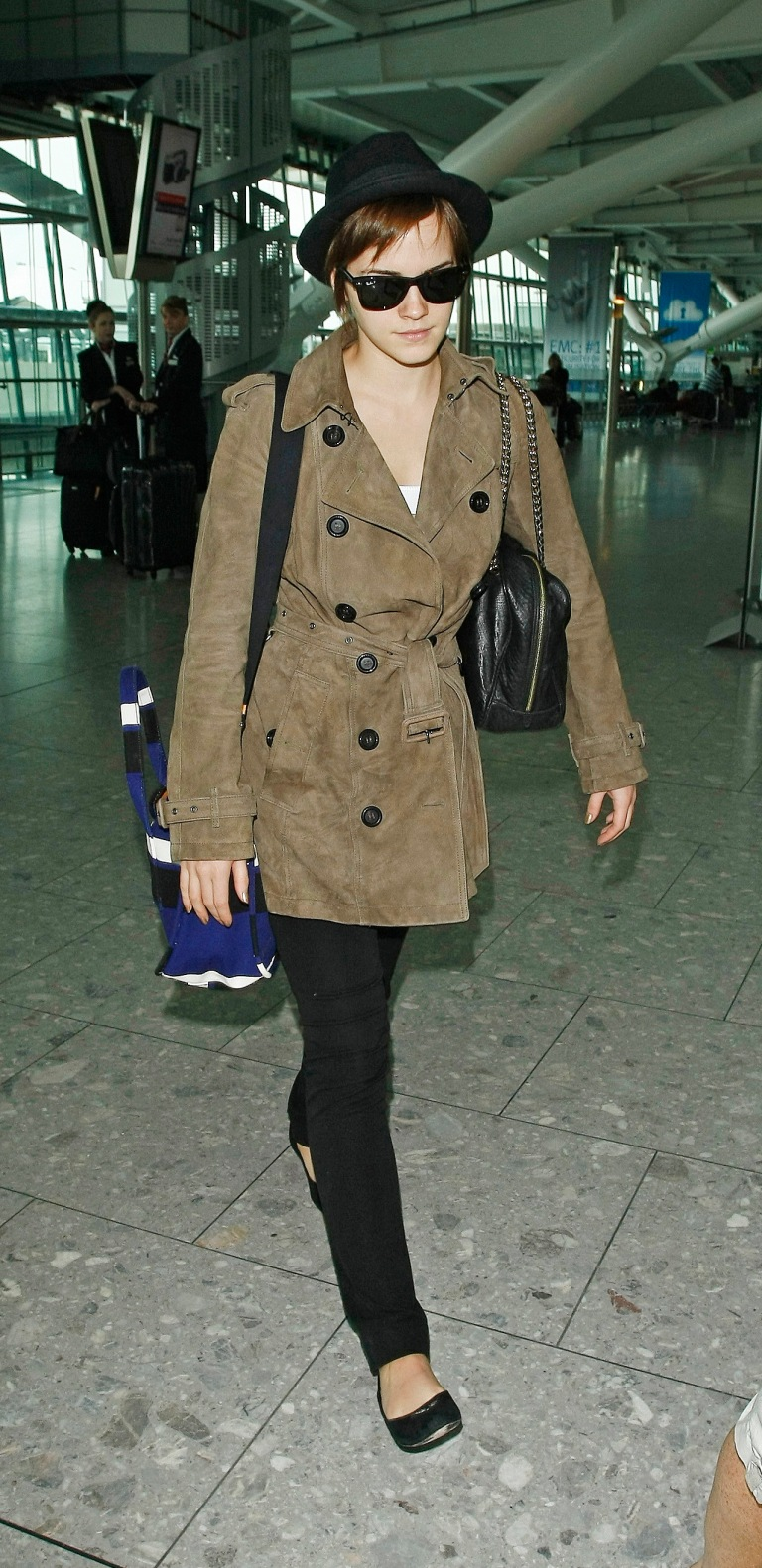 UK actress Emma Watson pictured at Heathrow Airport, leaving London, England, UK. Pictured: Emma Watson Ref: SPL295576 080711 Picture by: Colin MacFarlane / Splash News Splash News and Pictures Los Angeles:310-821-2666 New York: 212-619-2666 London: 870-934-2666 photodesk@splashnews.com